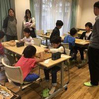 第3回将棋デーinプログラミング教室の経験者コースでの大会・予選で、子どもたちの戦いも白熱している様子